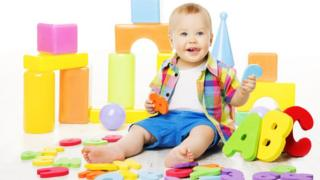 toddler with alphabet blocks