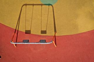 A children's playground lays dormant