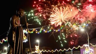 Fireworks explode near the Wheel of Light during Diwali celebrations in Leicester