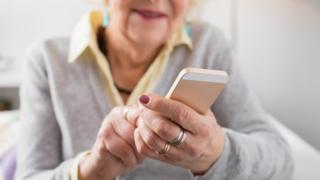 elderly woman using smartphone