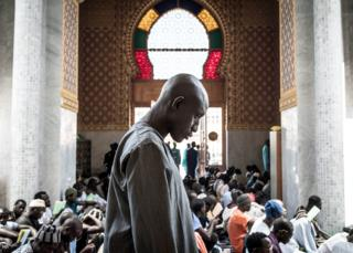 in_pictures A worshipper at a mosque in Dakar, Senegal - Wednesday 4 March 2020