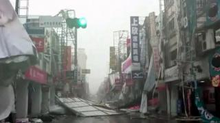 In this image made from video, wind-blown debris litters the street from Typhoon Nepartak in Taitung, south eastern Taiwan, Friday, July 8, 2016