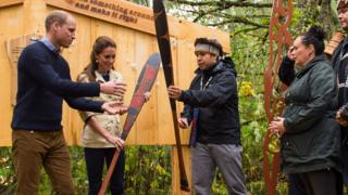 The Duke and Duchess of Cambridge are presented with canoe paddles as a gift from the Heiltsuk First Nation community during a visit to the Great Bear Rainforest in Bella Bella, Canada, during the third day of the Royal Tour to Canada