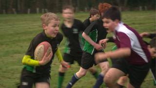 Schoolchildren playing rugby