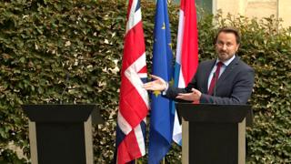 Luxembourg's Prime Minister Xavier Bettel gestures to an empty podium as he speaks to the press after meeting the UK Prime Minister in Luxembourg. 16 September 2019