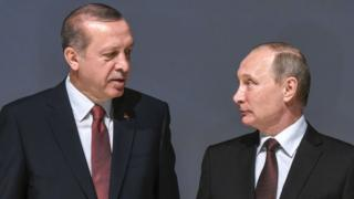This file photo taken on October 10, 2016 shows Russian President Vladimir Putin (R) listening to Turkish President Recep Tayyip Erdogan