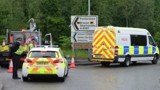 Police vehicles block entrance to A4067 at Pontardawe following crash
