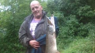 Scott Wilkinson holding a fish