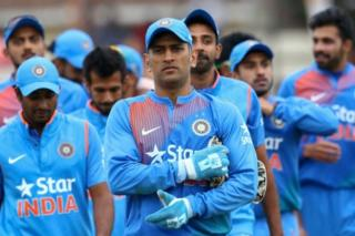 This file photo taken on June 22, 2016 shows India captain Mahendra Singh Dhoni leading his team after victory during the third and final T20 cricket match in a series of three games between India and Zimbabwe in the Prayag Cup at Harare Sports Club.