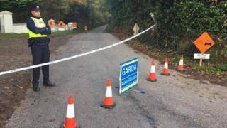 Gardaí (Irish police) have cordoned off a rural road outside Macroom