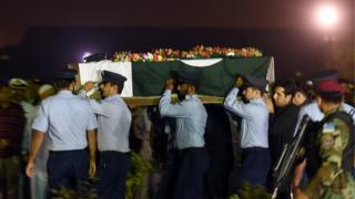 Pakistan Air Force (PAF) soldiers carry the coffin of female fighter jet pilot Marium Mukhtiar, who was killed in a crash during a training mission, at the Faisal Air Base in Karachi on November 24, 2015