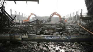 Excavators tear down a burnt down hall at Messe Duesseldorf, Germany, 8 June 2016