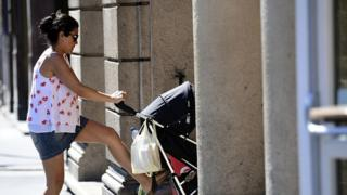 A mother pushes a pram in Budapest (11 July 2016)