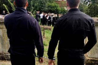 Elliot Murawski in handcuffs at his grandfather's funeral