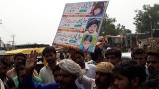 Protesters of Kasur with posters showing the missing boys