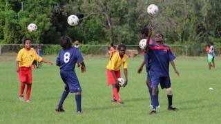 Children play football at Borroloola, in Australia's Northern Territory