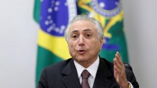Brazil's interim President Michel Temer gestures during a meeting with defence officials regarding the security of the 2016 Rio Olympics, at the Planalto Palace in Brasilia, Brazil, May 16, 2016.