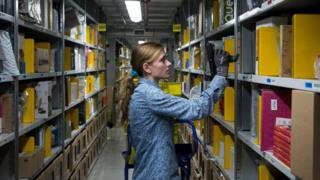 woman in Amazon warehouse