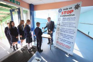 Chris Donnelly, principal of St John The Baptist Primary School in West Belfast with pupils