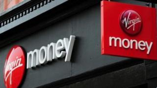 Close up of Virgin Money logos on branch