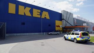A police car in front of an Ikea store in the central Swedish town of Vasteras on 10 August 2015