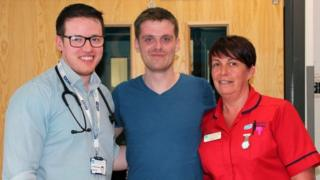 Matthew Bryce with consultant physician Dr Padraig Headley and ward sister Rhonda Marks as he left hospital