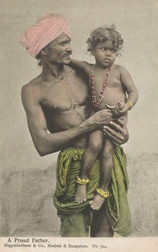 A turban-wearing Indian man holding his child