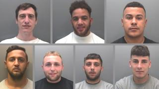 Headshots of an arrested gang of seven men