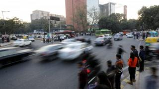 Vehicles drive on a road before the implementation of the odd-even vehicle scheme in New Delhi, India, 30 December 2015.