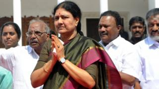 "This file photo taken on December 31, 2016 shows VK Sasikala, general secretary of southern Tamil Nadu state""s ruling All India Anna Dravida Munnetra Kazhagam (AIADMK), gesturing upon her arrival to take up office at the AIADMK headquarters in Chennai"