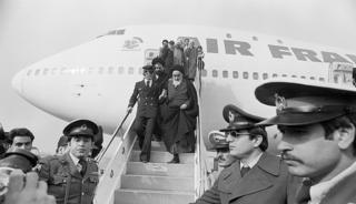 Ayatollah Khomeini and close companions getting off a plane