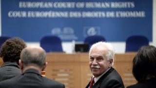 """Turkish politician Dogu Perincek from the left-wing Turkish Workers"""" Party looks on at the European Court of Human Rights in the eastern French city of Strasbourg"""