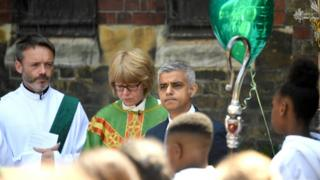 The Bishop of London Dame Sarah Mullally, London mayor Sadiq Khan and Graham Tomlinson, the Bishop of Kensington