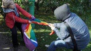 Gay rights activist and anti-gay activist fight over a rainbow flag in St Petersburg, Russia (Oct 2013)