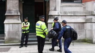 Police during a search of an address in Manchester
