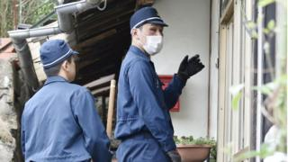 Police officers search properties on Mukaishima Island in Hiroshima Prefecture, 11 April 2018