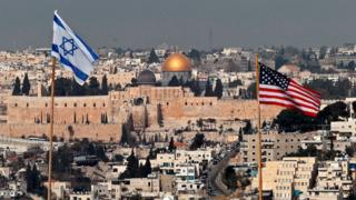 Israeli and US flags over Jerusalem