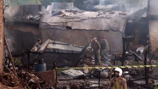 Pakistani soldiers cordon off the site where a Pakistani Army Aviation Corps aircraft crashed in Rawalpindi on July 30, 2019