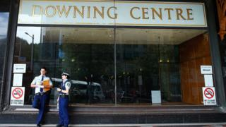 Two police officers stand outside Sydney's Downing Centre, where the trial was held.