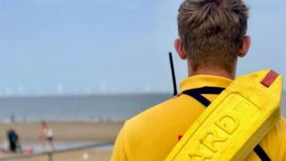 Lifeguard on beach in Skegness