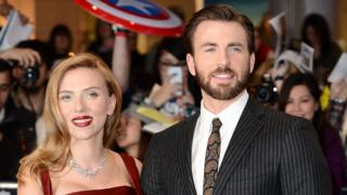 Scarlett Johansson and Chris Evans on the carpet before the Captain America: The Winter Soldier premiere.