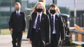 sports schoolchildren wearing masks