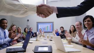Handshake in boardroom