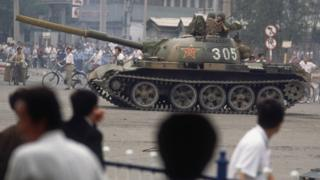 Tank and protesters in Tiananmen Square