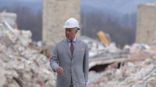 Prince Charles walks through Amatrice
