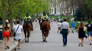Police in Victoria Park in east London on 11 April 2020