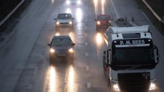 cars navigate rain on 30 September