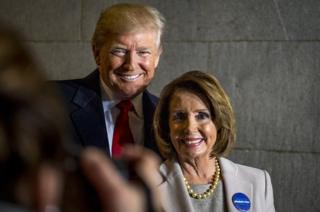 Donald Trump and Nancy Pelosi smile for a photo during his inauguration in Washington, D.C., on 20 January, 2017