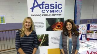 Two family support workers attending an Afasic Cymru information day