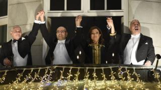 Nobel Peace Prize laureates of the Tunisian National Dialogue Quartet on the balcony of the Grand Hotel in Oslo to greet wellwishers on December 10, 2015
